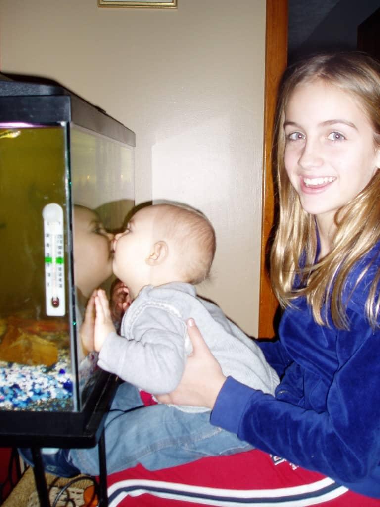 Kissing fishies with Sophia