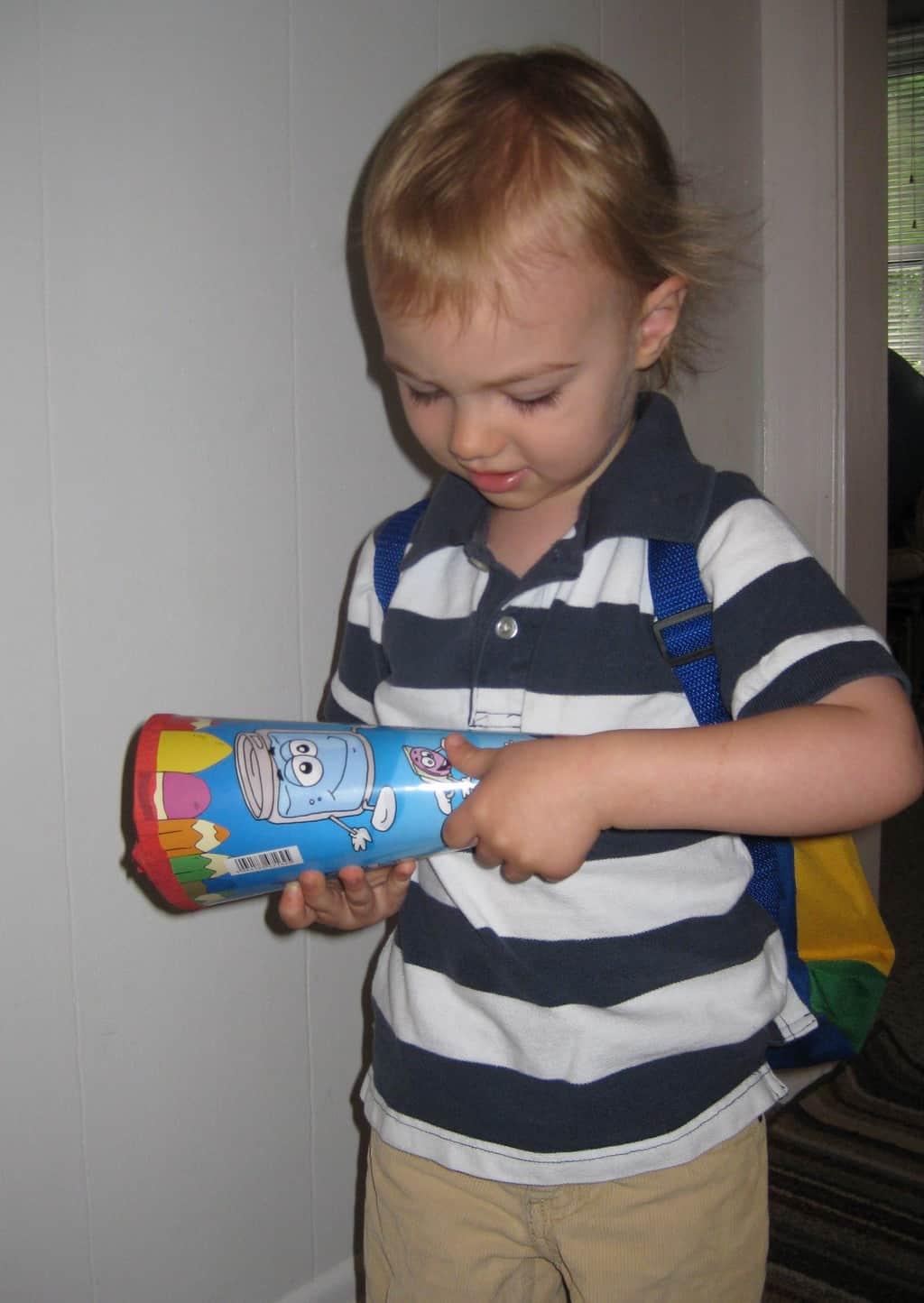 little boy getting ready for kindergarten