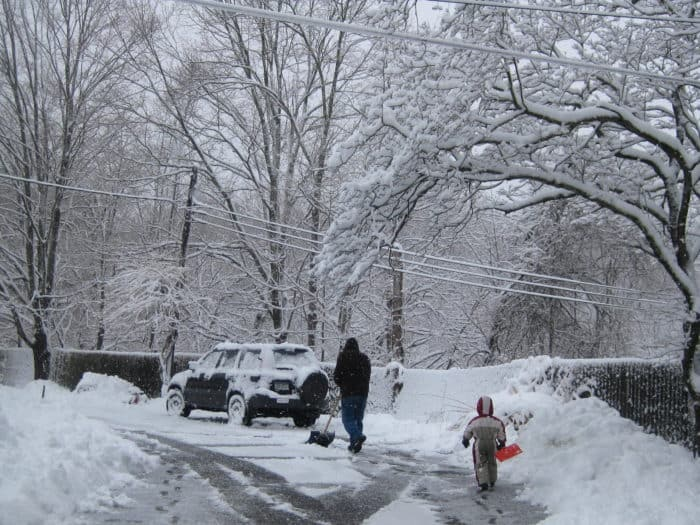 son and dad shoveling snow