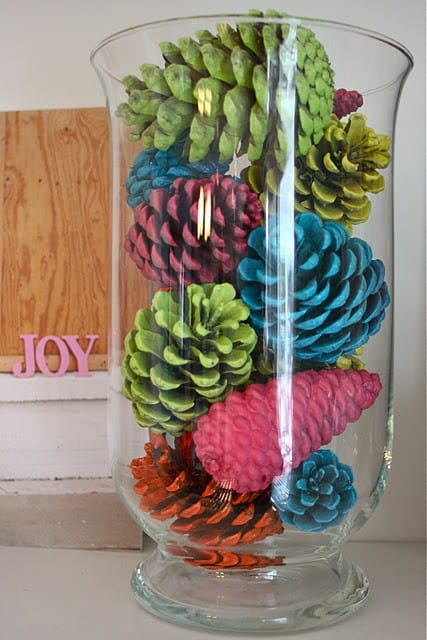 Pinterest DIY home decor, spray painted pine cones decoration in glass
