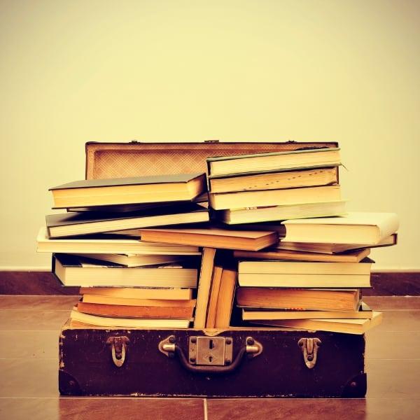 books in suitcase storage