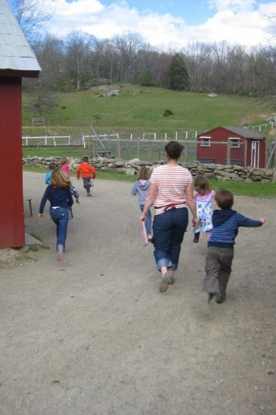 kids of 4-H group running on farm