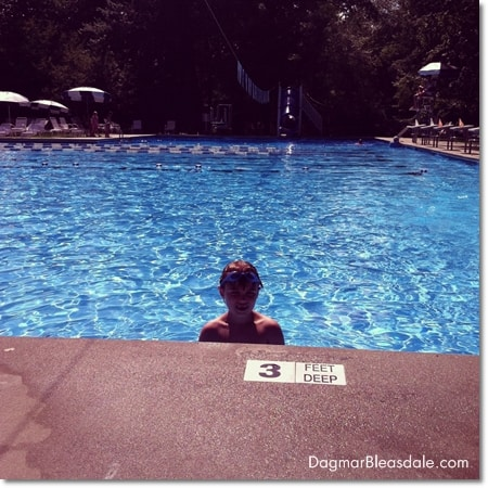 boy in pool looking at camera