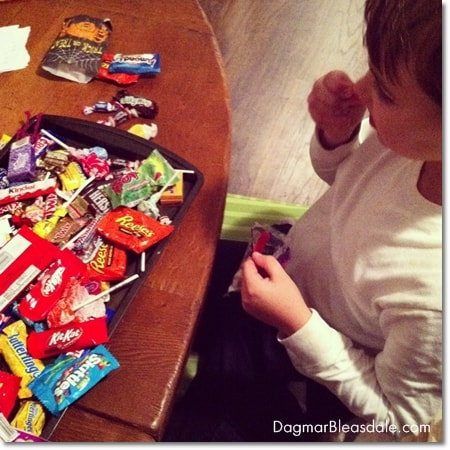 boy eating Halloween candy