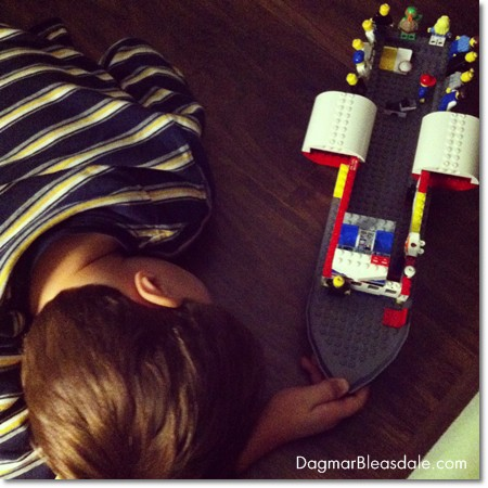 boy playing with LEGO Titanic