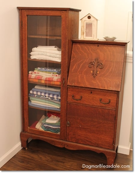 This Vintage Curio Cabinet is Now My Linen Closet