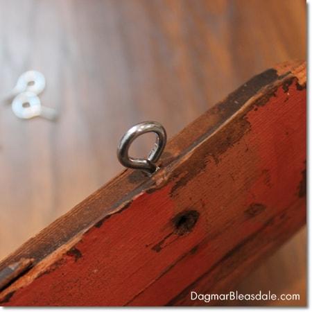 screw eye hooks on wood siding, salvaged wood sign
