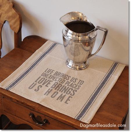 vintage silver water jug on table