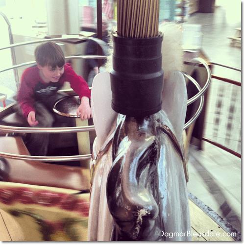 boy on carousel