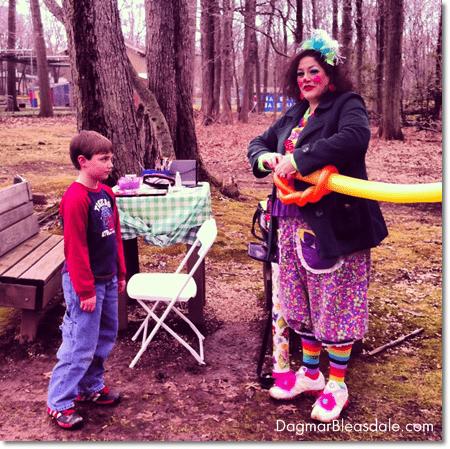clown making a balloon sword