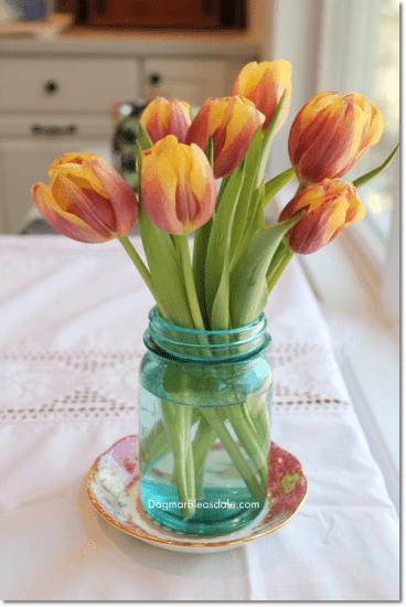tulips in vintage blue mason jar
