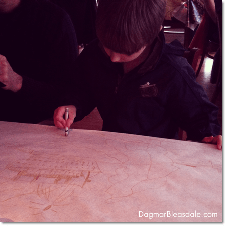 boy drawing on the table at a restaurant