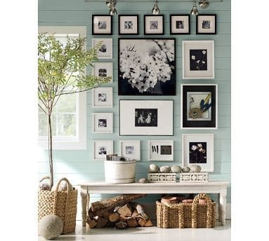 gallery wall over bench, black and white
