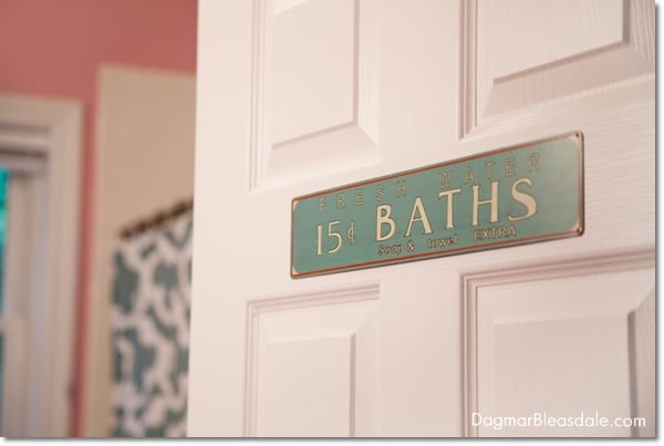 cottage bathroom, vintage sign on door