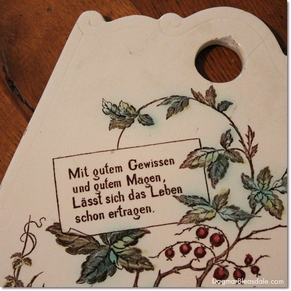 vintage porcelain cutting board with German saying