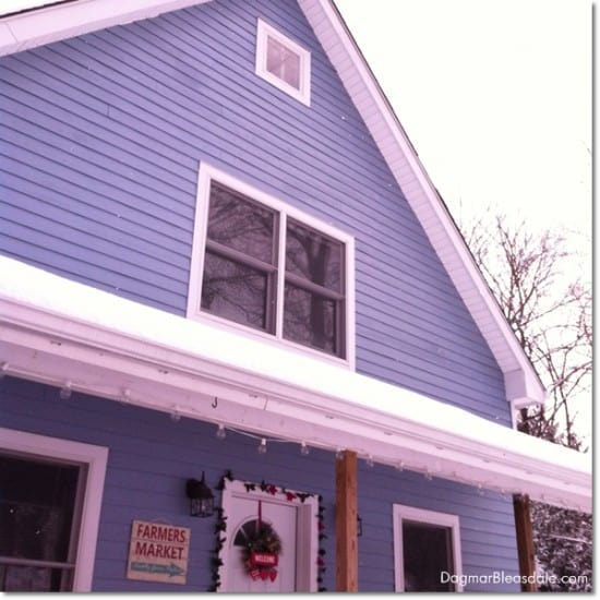 blue house with snow