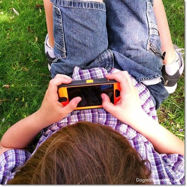 boy playing Minecraft on phone