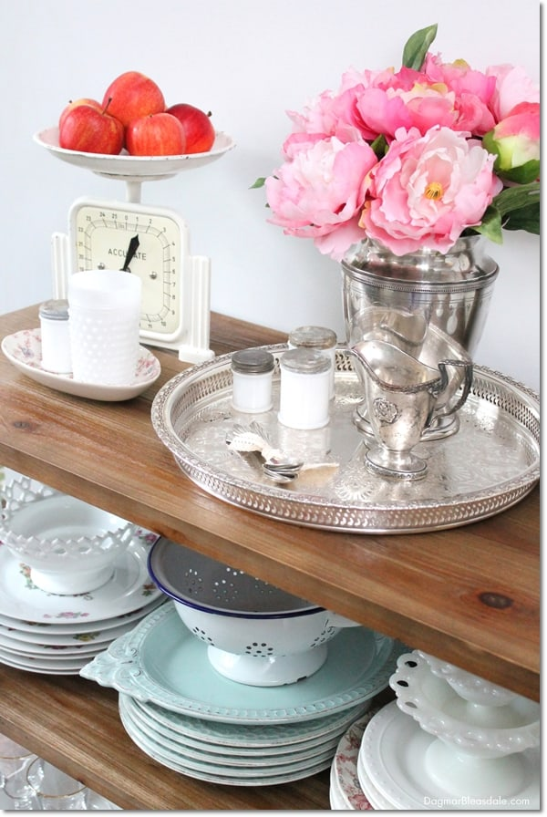 rustic console table with vintage dishes