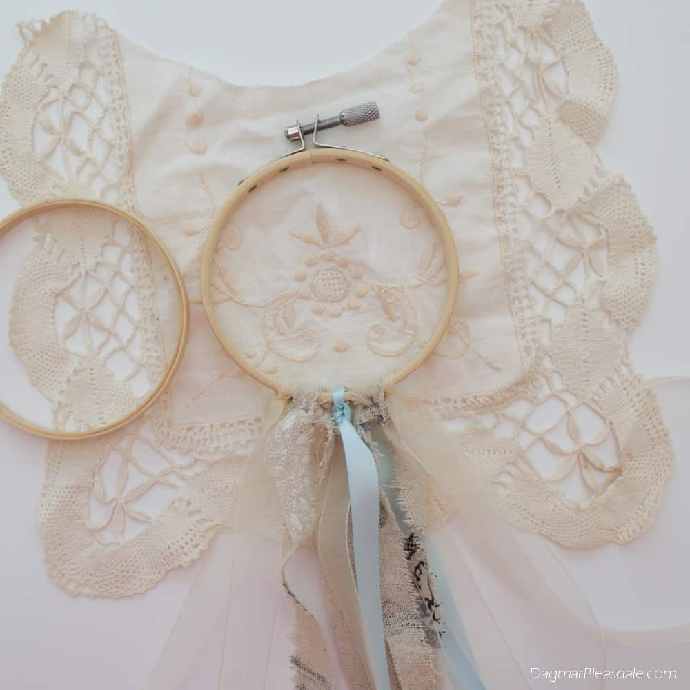 DIY dreamcatcher with ribbon, doily, and embroidery hoop