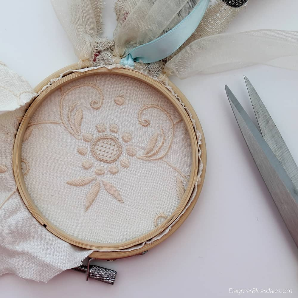 DIY dreamcatcher with lace, embroidery hoop, and ribbons