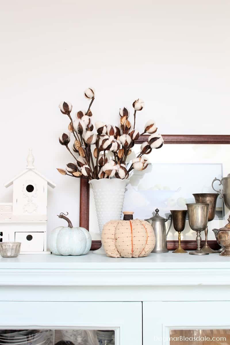 Cotton stems in vintage vase