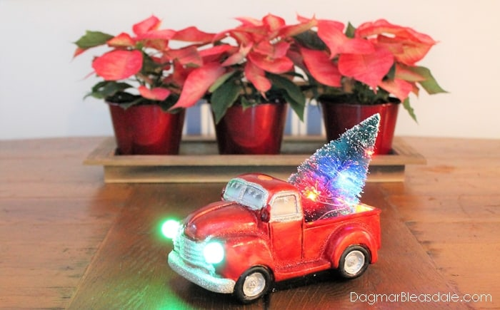 Red truck with tree and lights