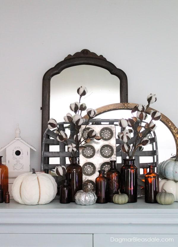 vignette with amber bottles, vintage decor